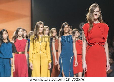 MADRID - FEBRUARY 17: models walking on the Juanjo Oliva catwalk during the Mercedes-Benz Fashion Week Madrid Fall/Winter 2014-2015 runway on February 17, 2014 in Madrid.  - stock photo
