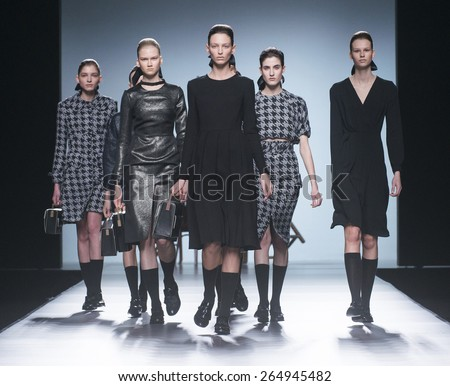 MADRID - FEBRUARY 08: models walking on the Moises Nieto catwalk during the Mercedes-Benz Fashion Week Madrid Fall/Winter 2015 runway on February 08, 2015 in Madrid.  - stock photo
