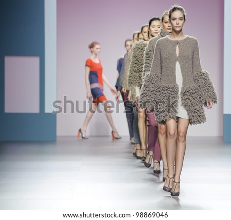 MADRID  FEBRUARY 04: Models walking on the Sita Murt catwalk during the Mercedes-Benz Fashion Week Madrid runway on February 04, 2012 in Madrid, Spain. - stock photo