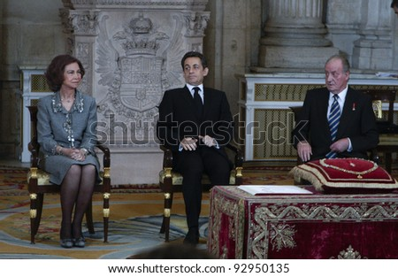 MADRID - JANUARY 16: French President Nicolas Sarkozy receives one of Spain's highest honors, the Order of the Golden Fleece, from King Juan Carlos I at the Royal Palace on January 16, 2012 in Madrid