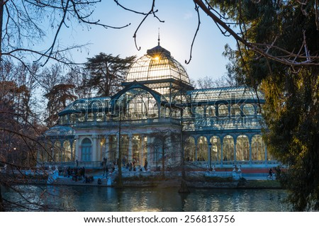 MADRID - JANUARY 24: Tourists and locals gather outside the Crystal Palace in the Retiro Park in Madrid on a cold winter afternoon, on January 24, 2015. - stock photo
