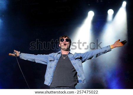 MADRID - JUN 25: Tom Meighan, singer of Kasabian band, performs at Universidad Complutense on June 25, 2011 in Madrid, Spain. First edition of Dcode Festival. - stock photo