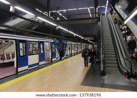 MADRID - OCTOBER 24: People exit Madrid Metro on October 24, 2012 in Madrid. Madrid Metro has annual ridership of 634 million passengers (2011). - stock photo