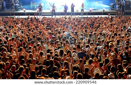 MADRID - SEP 13: Aerial view of people in a concert at Dcode Festival on September 13, 2014 in Madrid, Spain. - stock photo