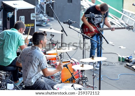 MADRID - SEP 13: Double drummers and guitar player of Perro (band) in concert at Dcode Festival on September 13, 2014 in Madrid, Spain. - stock photo
