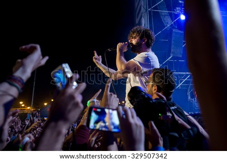 MADRID - SEP 12: Yannis Philipakkis, lead singer of Foals (band), performs with the crowd at Dcode Festival on September 12, 2015 in Madrid, Spain.