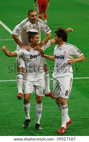 MADRID - SEPT 30: Cristiano Ronaldo (C), Kaka (R) and Karim Benzema celebrate the first goal of Real Madrid's 3-0 victory over Olympique Marseille in Champions League group stage action September 30, 2009 in Madrid. - stock photo