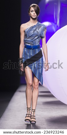 MADRID - SEPTEMBER 15: a model walks on the Alvarno catwalk during the Mercedes-Benz Fashion Week Madrid Spring/Summer 2015 runway on September 15, 2014 in Madrid.  - stock photo
