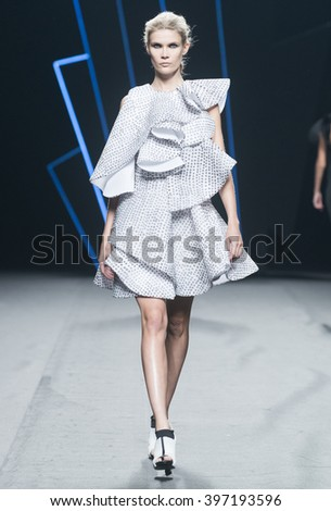 MADRID - SEPTEMBER 19: a model walks on the Amaya Arzuaga catwalk during the Mercedes-Benz Fashion Week Madrid Spring/Summer 2016 runway on September 19, 2015 in Madrid.  - stock photo