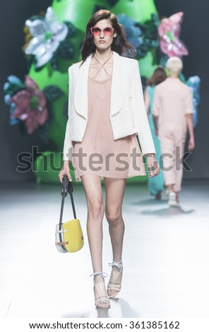 MADRID - SEPTEMBER 19: a model walks on the Ana Locking catwalk during the Mercedes-Benz Fashion Week Madrid Spring/Summer 2016 runway on September 19, 2015 in Madrid.  - stock photo