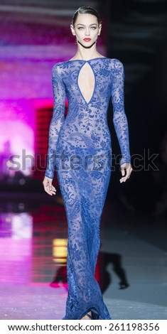 MADRID - SEPTEMBER 15: a model walks on the Andres Sarda catwalk during the Mercedes-Benz Fashion Week Madrid Spring/Summer 2015 runway on September 15, 2014 in Madrid.  - stock photo