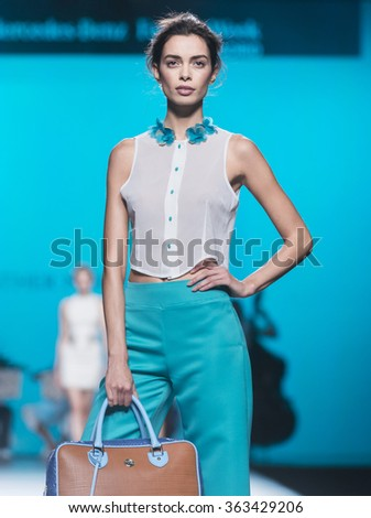 MADRID - SEPTEMBER 20: a model walks on the Esther Noriega catwalk during the Mercedes-Benz Fashion Week Madrid Spring/Summer 2016 runway on September 20, 2015 in Madrid.  - stock photo