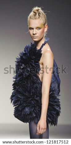 MADRID - SEPTEMBER 03: A model walks on the Eva Soto Conde catwalk during the Cibeles Madrid Fashion Week runway on September 03, 2012 in Madrid.