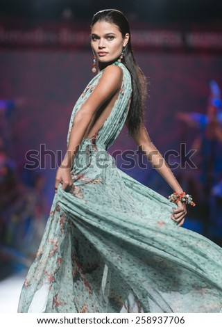 MADRID - SEPTEMBER 12: a model walks on the Francis Montesinos catwalk during the Mercedes-Benz Fashion Week Madrid Spring/Summer 2015 runway on September 12, 2014 in Madrid.  - stock photo