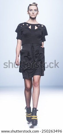 MADRID - SEPTEMBER 15: a model walks on the Leyre Valiente catwalk during the Mercedes-Benz Fashion Week Madrid Spring/Summer 2015 runway on September 15, 2014 in Madrid.  - stock photo