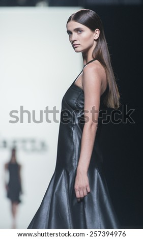 MADRID - SEPTEMBER 13: a model walks on the Roberto Torretta catwalk during the Mercedes-Benz Fashion Week Madrid Spring/Summer 2015 runway on September 13, 2014 in Madrid.  - stock photo