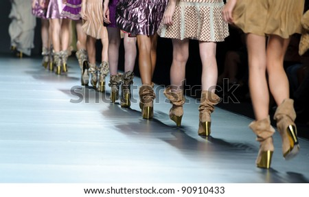 MADRID – SEPTEMBER 17: Details of models walking on the Teresa Helbig catwalk during the Cibeles Madrid Fashion Week runway on September 17, 2011 in Madrid. - stock photo