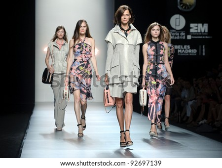 MADRID – SEPTEMBER 16: Models walking on the Adolfo Dominguez catwalk during the Cibeles Madrid Fashion Week runway on September 16, 2011 in Madrid, Spain.. - stock photo