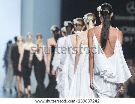 MADRID - SEPTEMBER 13: models walking on the Juana Martin catwalk during the Mercedes-Benz Fashion Week Madrid Spring/Summer 2015 runway on September 13, 2014 in Madrid.  - stock photo