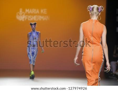 MADRID - SEPTEMBER 04: Models walking on the Maria Ke Fisherman catwalk during the Cibeles Madrid Fashion Week runway on September 04, 2012 in Madrid. - stock photo