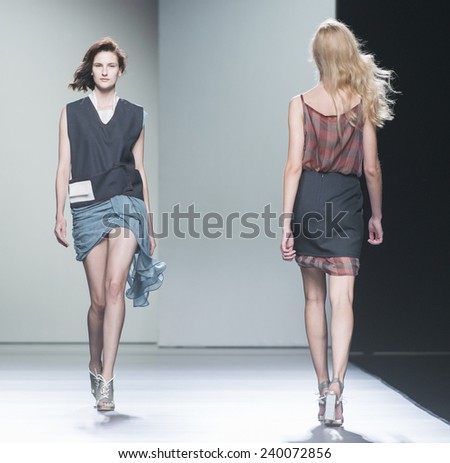 MADRID - SEPTEMBER 14: models walking on the Rabaneda catwalk during the Mercedes-Benz Fashion Week Madrid Spring/Summer 2015 runway on September 14, 2014 in Madrid.