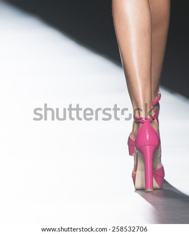 MADRID - SEPTEMBER 11: shoes details on the Desigual catwalk during the Mercedes-Benz Fashion Week Madrid Spring/Summer 2015 runway on September 11, 2014 in Madrid.  - stock photo