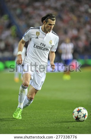 MADRID, SPAIN - April 22nd, 2015 :  GARETH BALE of  REAL MADRID in action  during the UEFA Champions League match vs ATLETICO DE MADRID at Santiago Bernabeu Stadium - stock photo