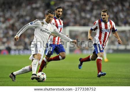 MADRID, SPAIN -April 22nd, 2014 :  Portuguese CRISTIANO RONALDO of REAL MADRID in action during Europe Champions League match vs ATLETICO at Santiago Bernabeu Stadium  - stock photo