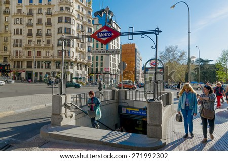 MADRID, SPAIN - APRIL 1: People near plaza de Espana Metro Station on April 1, 2015 in Madrid, Spain. Spain square metro station is one of the most centric in the city of Madrid - stock photo