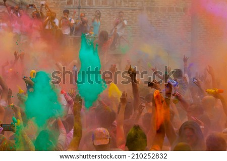 MADRID SPAIN -AUG 9: People celebrated Monsoon Holi Festival of Colors on August 9, 2014 in Madrid, Spain. People dancing and celebrating during the color throw.  - stock photo