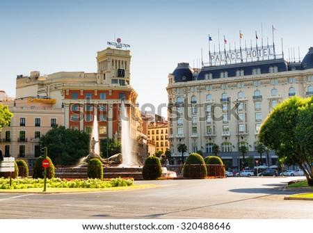 MADRID, SPAIN - AUGUST 20, 2014: View of Fuente de Neptuno (Neptune Fountain) on Plaza Canovas del Castillo in Madrid, Spain. Madrid is a popular tourist destination of Europe. - stock photo