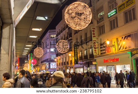 MADRID,SPAIN - DECEMBER 18: The streets of Madrid are filled with lights and people doing their Christmas shopping December 18, 2014 in Madrid Spain - stock photo