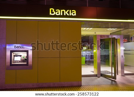 MADRID, SPAIN - FEBRUARY 24, 2015: A Bankia branch. Bankia was the result of a merger of several failed savings banks and has been in the eye of several political scandals since.   - stock photo