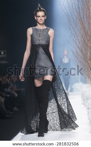 MADRID, SPAIN - FEBRUARY 10: A model walks on the Alvarno catwalk during the Mercedes-Benz Fashion Week Madrid Fall/Winter 2015 runway on February 10, 2015 in Madrid. - stock photo