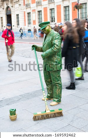 MADRID, SPAIN - FEBRUARY 16: Mimes on square Puerta del Sol entertain public on February 16, 2013 in Madrid, Spain - stock photo