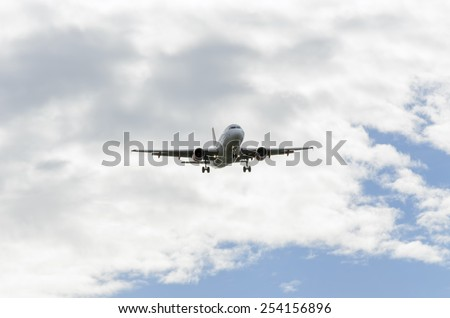 MADRID, SPAIN - FEBRUARY 14th 2015: Airplane -Airbus A319-, of -EasyJet- airline, approaching to Madrid-Barajas -Adolfo Suarez- airport, throught of clouds, on February 14th 2015. - stock photo