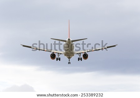 MADRID, SPAIN - FEBRUARY 14th 2015: Airplane -Airbus A319-, of -EasyJet- airline, landing on Madrid-Barajas -Adolfo Suarez- airport, on February 14th 2015. - stock photo