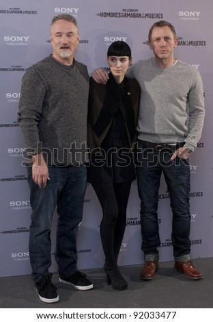 MADRID, SPAIN - JANUARY 04: Actor Daniel Craig, actress Rooney Mara and director David Fincher present 'The Girl With The Dragon Tattoo' at Villamagna hotel on January 4, 2012 in Madrid, Spain. - stock photo
