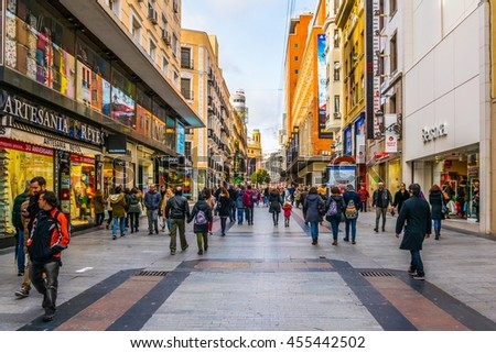 MADRID, SPAIN, JANUARY 9, 2016: people are strolling over calle de arenal towards puerta del sol square in the spanish capital madrid