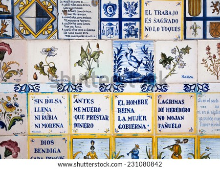 MADRID, SPAIN - July 22, 2014:  Decorative tiles on Madrid street. National decorative art with agricultural symbols - stock photo