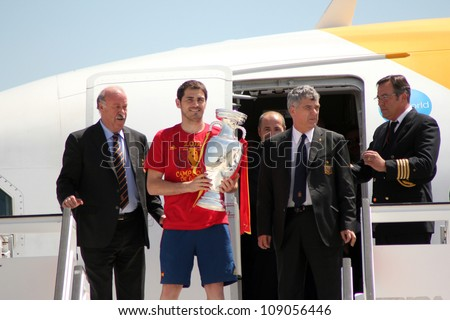 MADRID, SPAIN  JULY 7: Iker Casillas and Vicente Del Bosque show the trophy upon arrival to Madrid after winning the 2012 Eurocup. On July 7, 2012 at Barajas airport. - stock photo