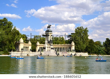 MADRID, SPAIN - JULY 4: People enjoying a boat ride on the pond in El Retiro Park in Madrid, Spain on July 4, 2012. El Retiro occupies 1.18 km2 and is the largest park of the city of Madrid.