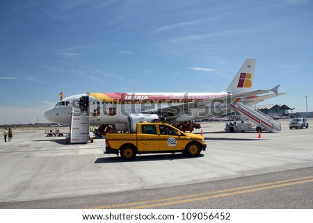 MADRID, SPAIN  JULY 7: The Spanish national team's plane upon arrival to Madrid after winning the 2012 Eurocup. On July 7, 2012 at Barajas airport. - stock photo
