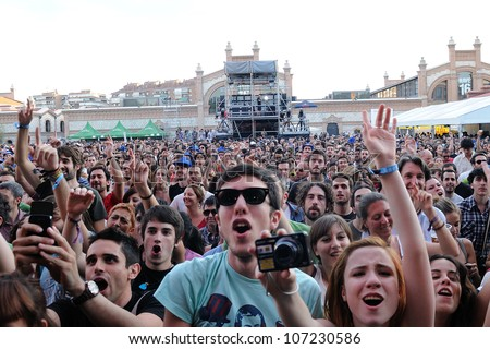 MADRID, SPAIN - JUNE 23: Fans at Love of Lesbian band concert at Matadero de Madrid on June 23, 2012 in Madrid, Spain. Dia de la Musica Festival. - stock photo