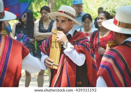 MADRID, SPAIN - JUNE 19: Party summer solstice Quechua Indians in the Retiro Park on June 19, 2016 in Madrid, Spain.