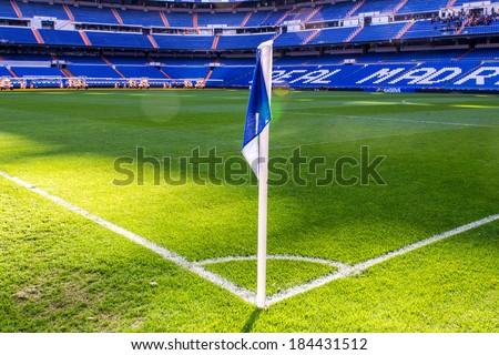 MADRID, SPAIN - MAR 11, 2014: Corner flag at the Santiago Bernabeu stadium. Santiago Bernabeu is a home arena for the Real Madrid Club de Futbol - stock photo