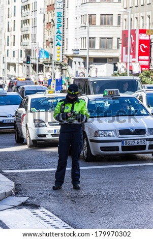 MADRID, SPAIN - MAR 4, 2014: Police woman on Gran Via street (Great Way), Madrid, Spain. Gran via is known as the the street that never sleeps or as Spanish Brodway