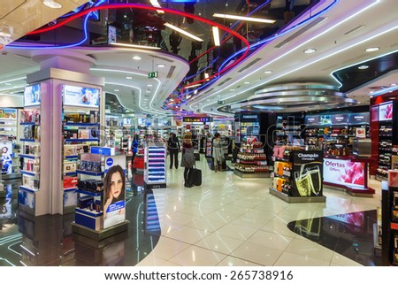 MADRID, SPAIN-MARCH 18, 2015: Duty free shop with unidentified people at Madrid-Barajas Airport, the main international airport serving Madrid, with about 39 million passengers Europes 6th the busiest - stock photo