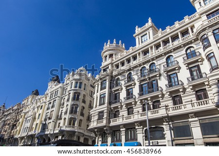 MADRID, SPAIN- MARCH 16, 2016: Gran Vi­a is an ornate and upscale shopping street located in central Madrid. Street is known as the Spanish Broadway.