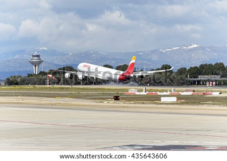 MADRID, SPAIN - MARCH 05th 2016: Airliner -Airbus A340-, of spanish airline -Iberia-, is landing in Madrid Barajas airport (Spain), on March 05th 2016. - stock photo